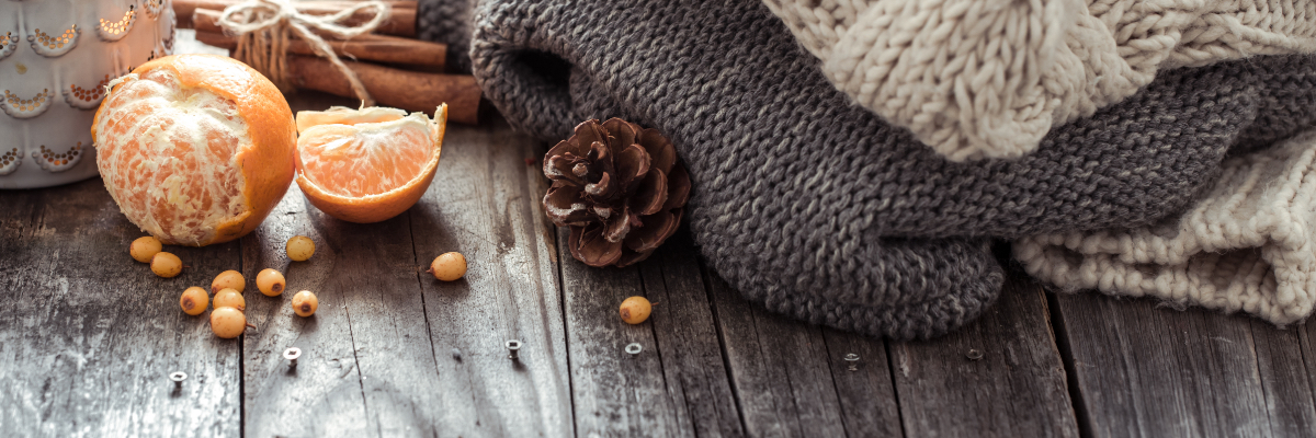 winter blanket with oranges and pinecones