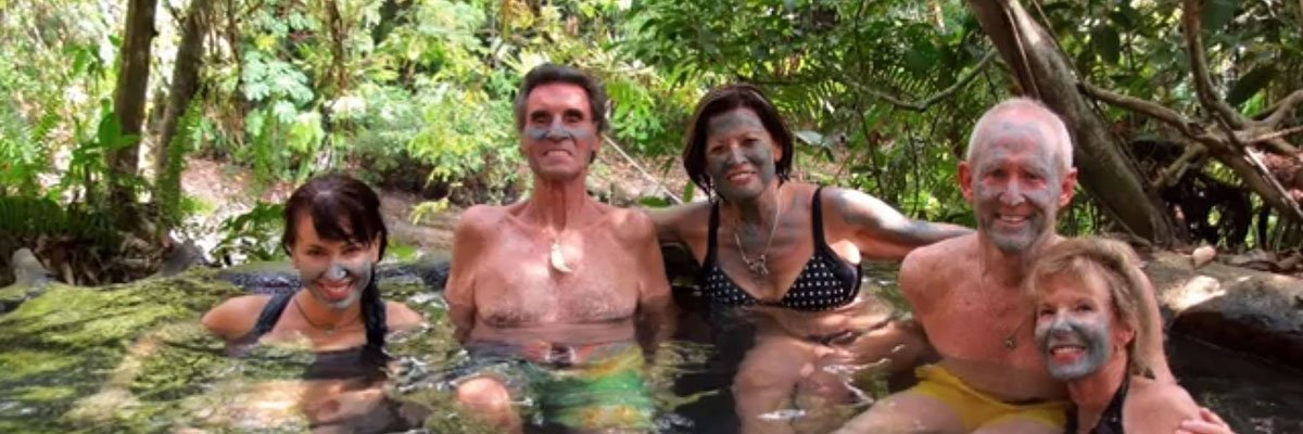 Friends in a hot spring covered in mud