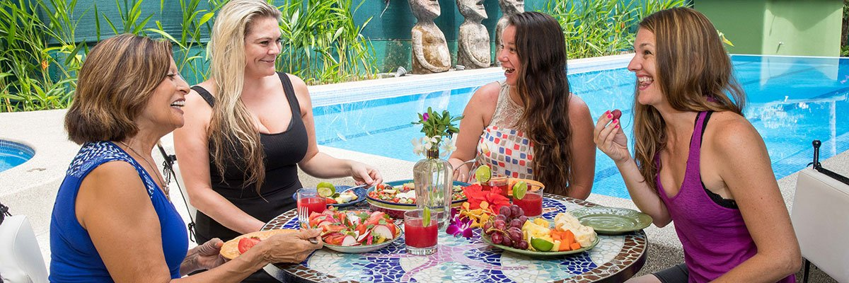 Women lunching by the pool