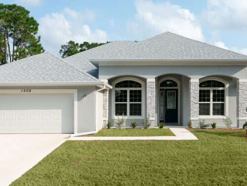 Exterior image of a pale blue Saraceno Model Home