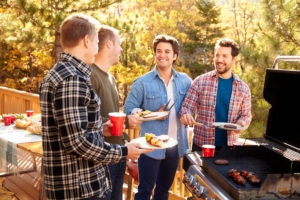 Group Male Friends Enjoying Barbeque Together