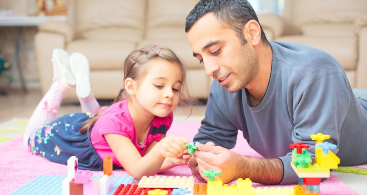 Father And Little Daughter Are Playing With Toys