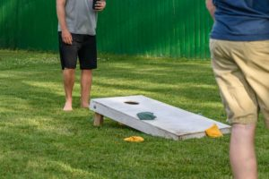 two guys playing corn hole