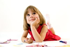 Little girl looking for a drawing concept