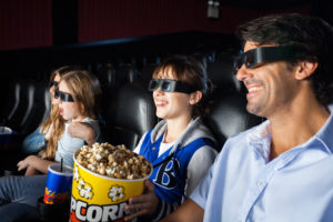 Father childred enjoying 3D movie in cinema theater