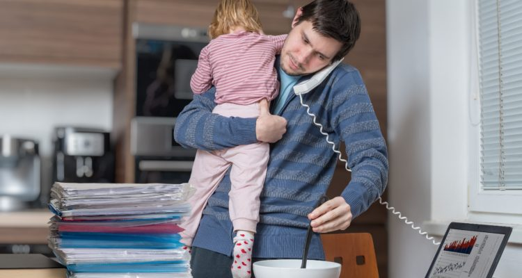 Multitasking father at home.