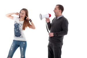 father shouting at daughter with mega phone