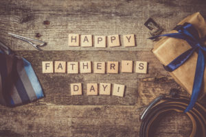 Father's day concept - present, tie on rustic wood background,