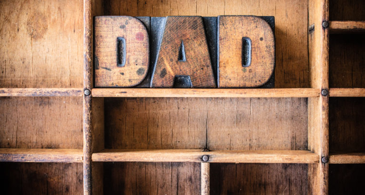 The word DAD written in vintage wooden letterpress type in a wooden type drawer.
