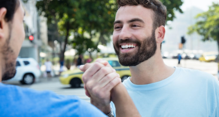 Men greeting each other with handshake