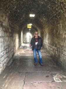 Our guide, Sedar, in treatment tunnel.