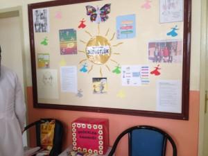 portrait on lower left of bulletin board