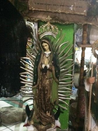 Virgin of Guadalupe, similar to the one carried by a young boy this morning