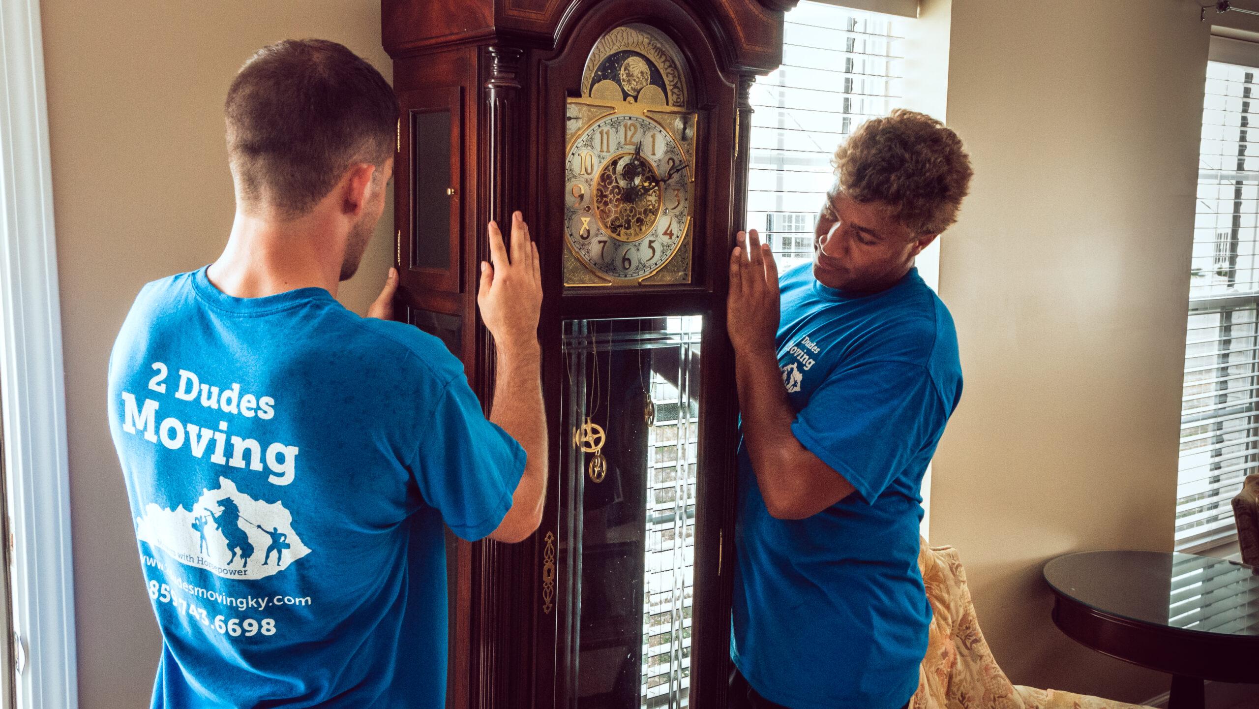 2 Dudes Moving A Grandfather Clock