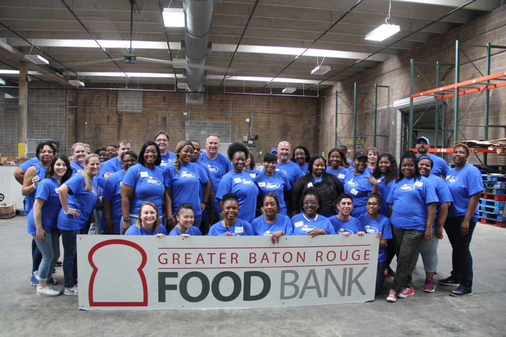 Neighbors staff volunteering at the Greater Baton Rouge Food Bank for Neighbors Day