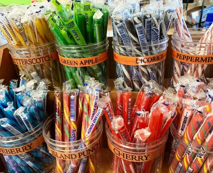 containers of various stick candy