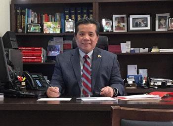 Tony Du sitting at a desk