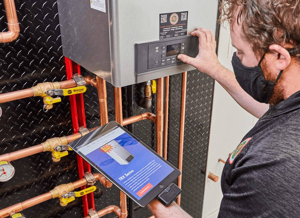 Flow Masters Plumbng boiler technician checks boiler settings