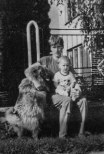Tomas Banik at a young age with the family pet dog Goro.