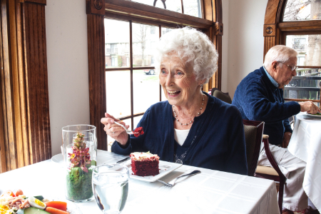 An image of a resident enjoying a meal.