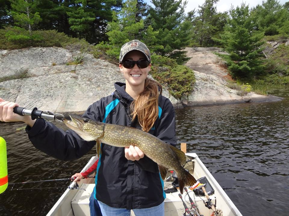 Girl holding a French River Delta Pike