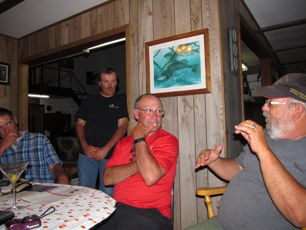 Bill Hamblin Listening to Art Barefoot explaining Musky Fishing French River