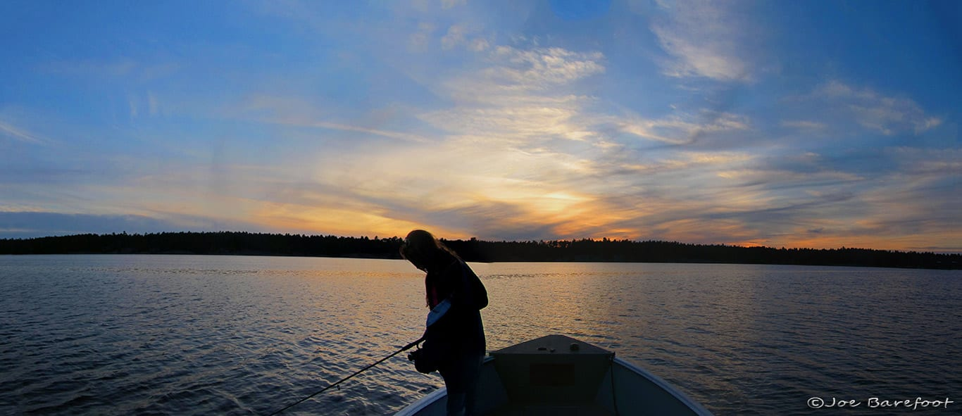 Fishing French River with a sunset and a Female Angler