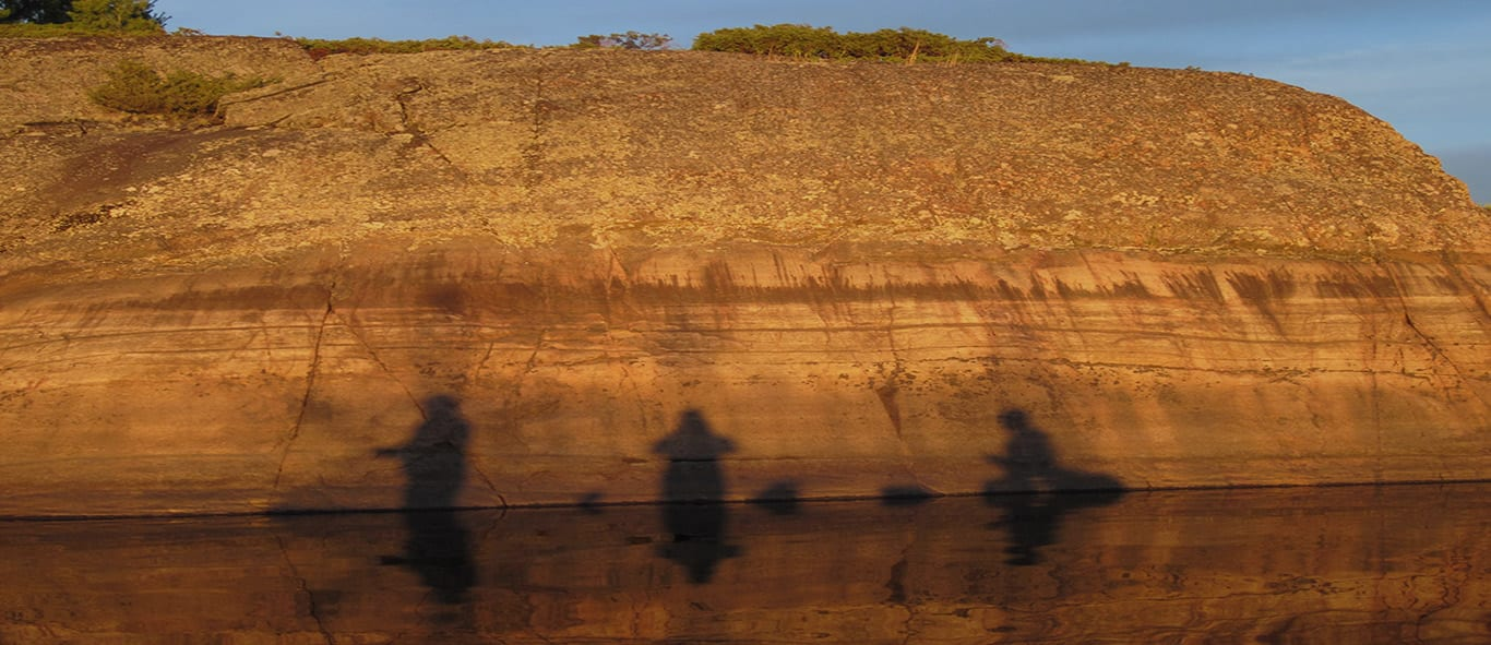 3 Fishermen's Shadows on the Canadian Shield in the French River Provincial Park, Northeastern Canada