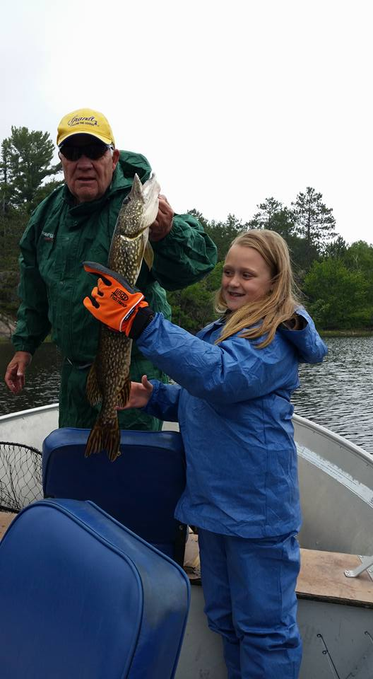 Girl and father pike fishing in Ontario