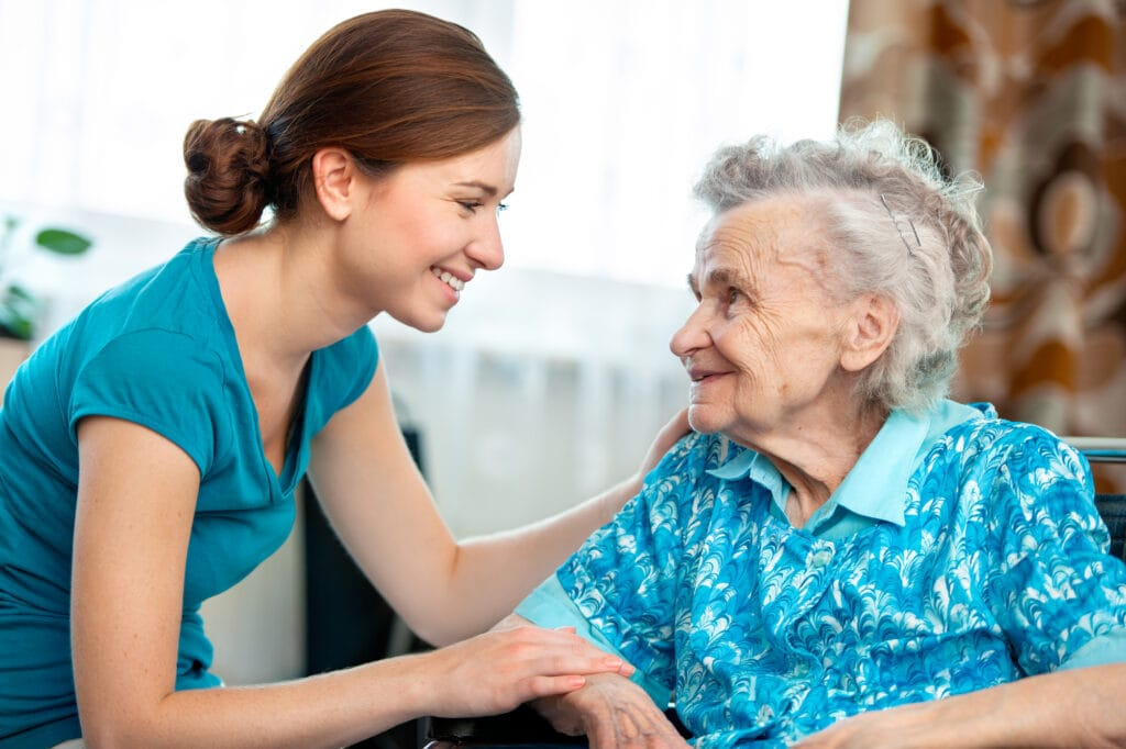 caregiver helping client at home