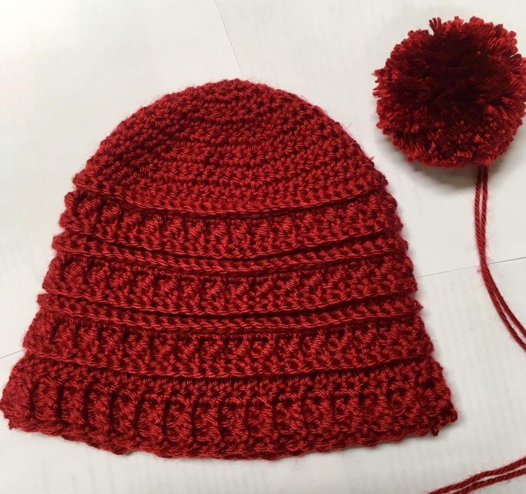 Pom-Pom and crochet hat