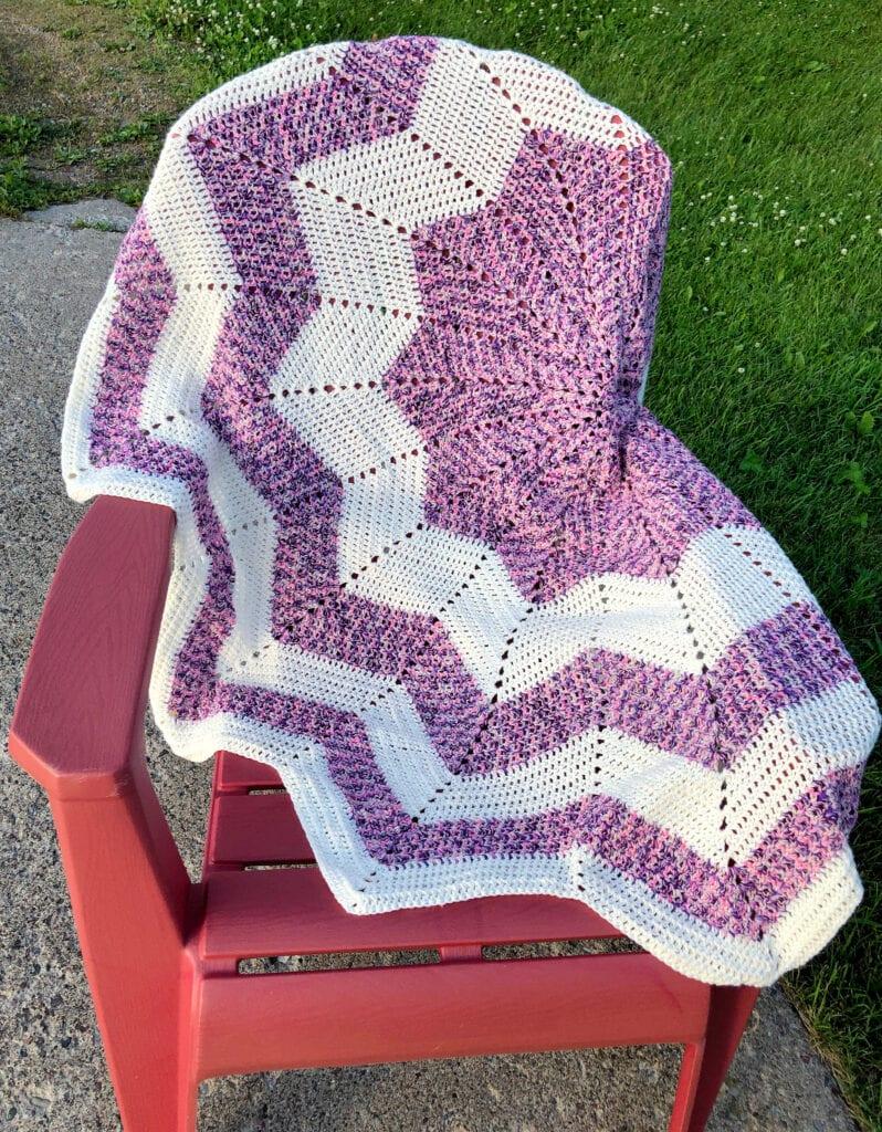 Crochet 12-Point Star Blanket Over Chair Outside