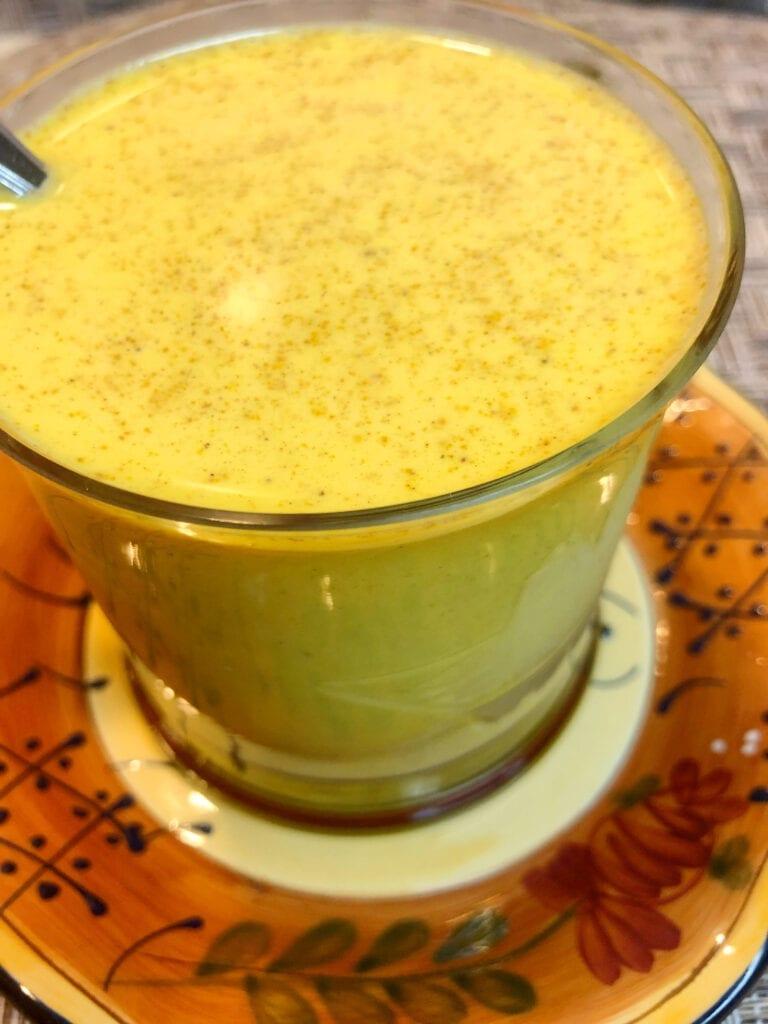 Turmeric Tea Drink in Glass Coffee Cup