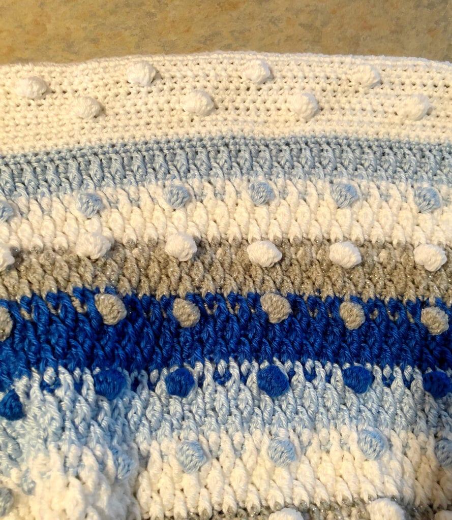 Close up of Bobble Stitches, Alpine Stitches, and Crochet Border