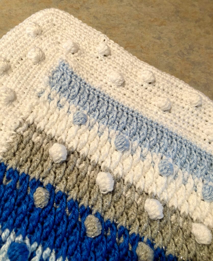 Close up of Bobble Texture Blanket Corner and Border