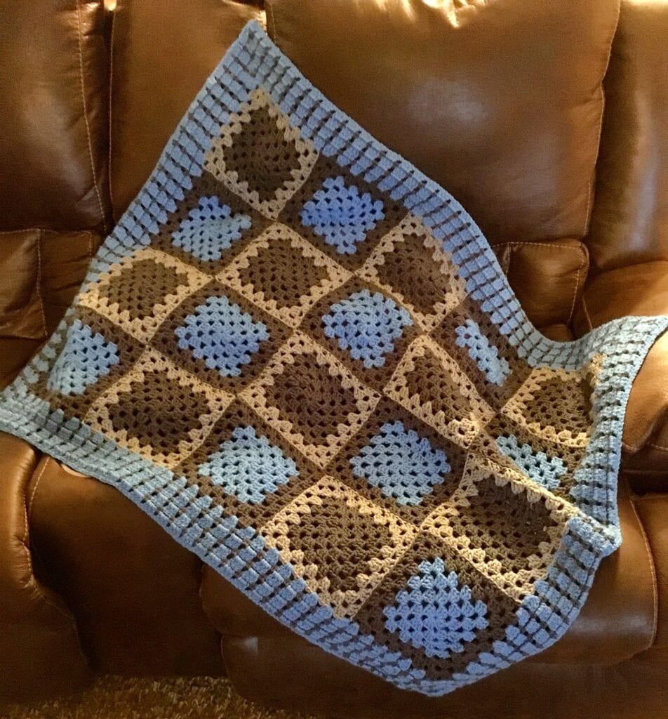 Bright Blue and Grey Baby Blanket displayed on chair