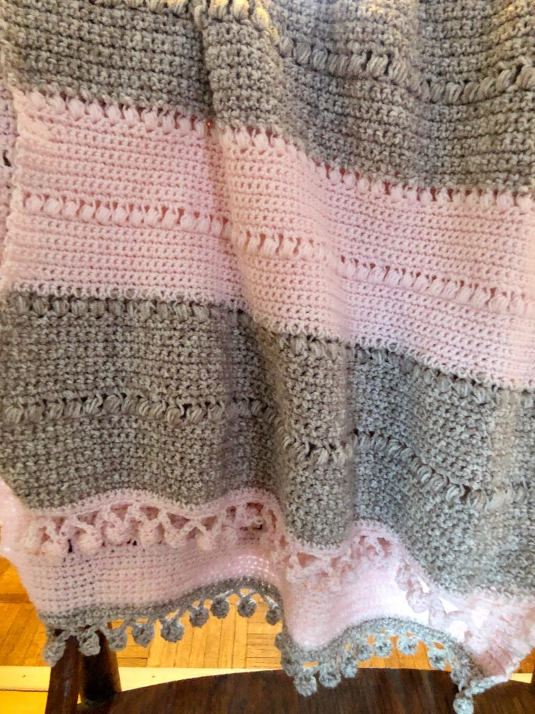 Crochet Shawl Wrap Hanging Over the Back of a Chair