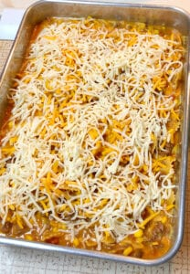 Sprinkle Shredded Cheese on top of the Casserole
