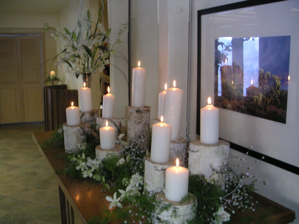 Featured image showing a winter wedding at Squaw Valley Chapel. Entryway table with candles and flowers.