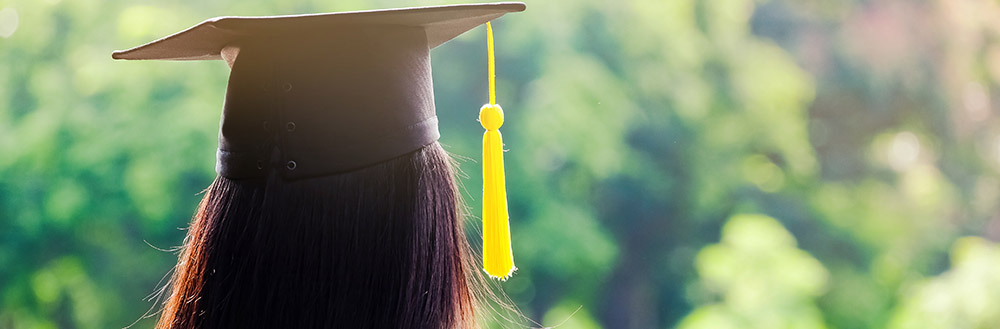 Photo of the Back of Graduate Wearing a Mortar Board