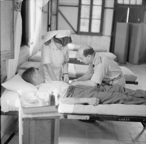 A patient receiving an injection of pentothal at No 41 General Hospital, Kantara East, which specialised in psychiatric treatment. © IWM (E 24690)