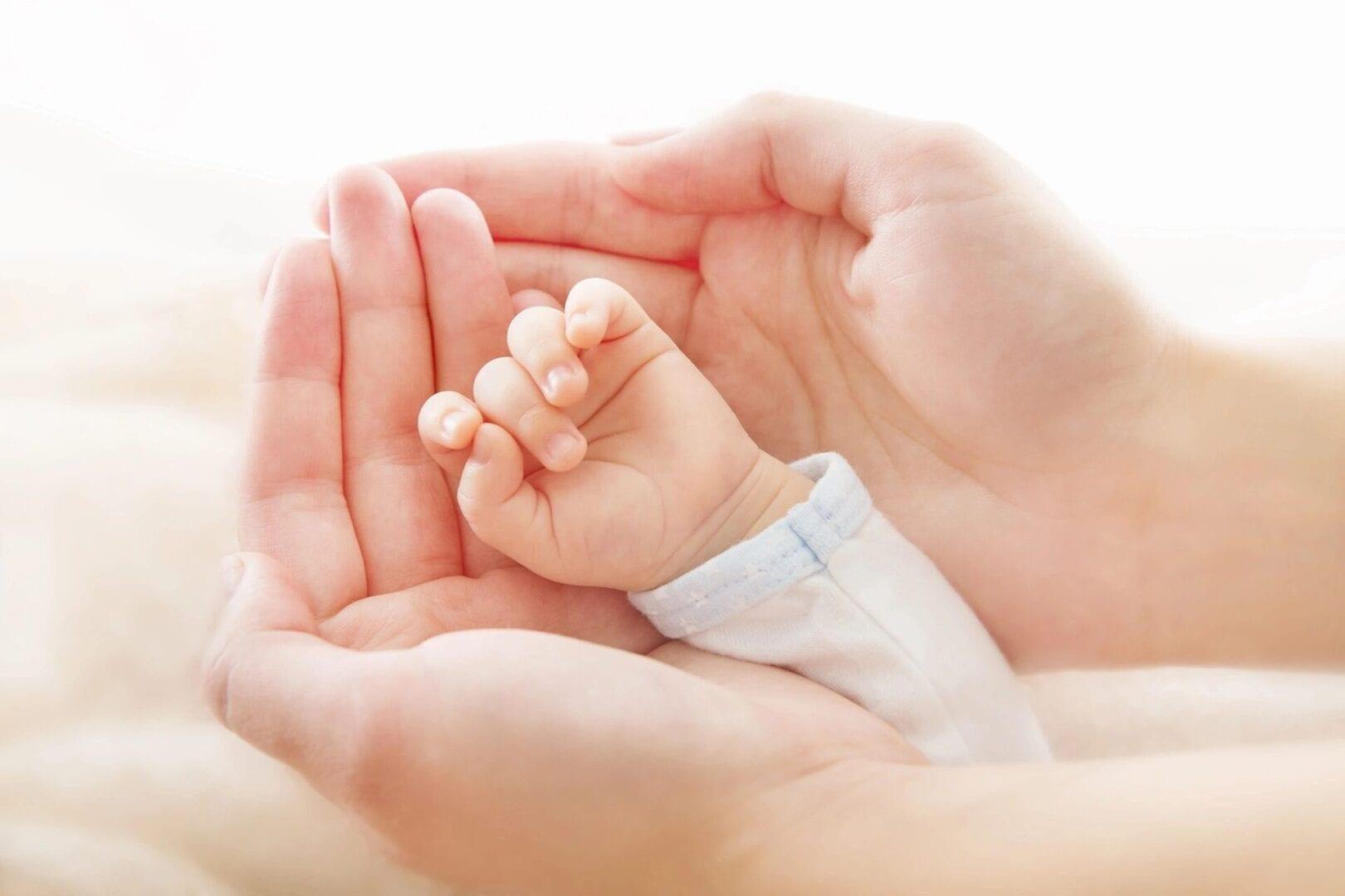 Baby hand in Adult hands