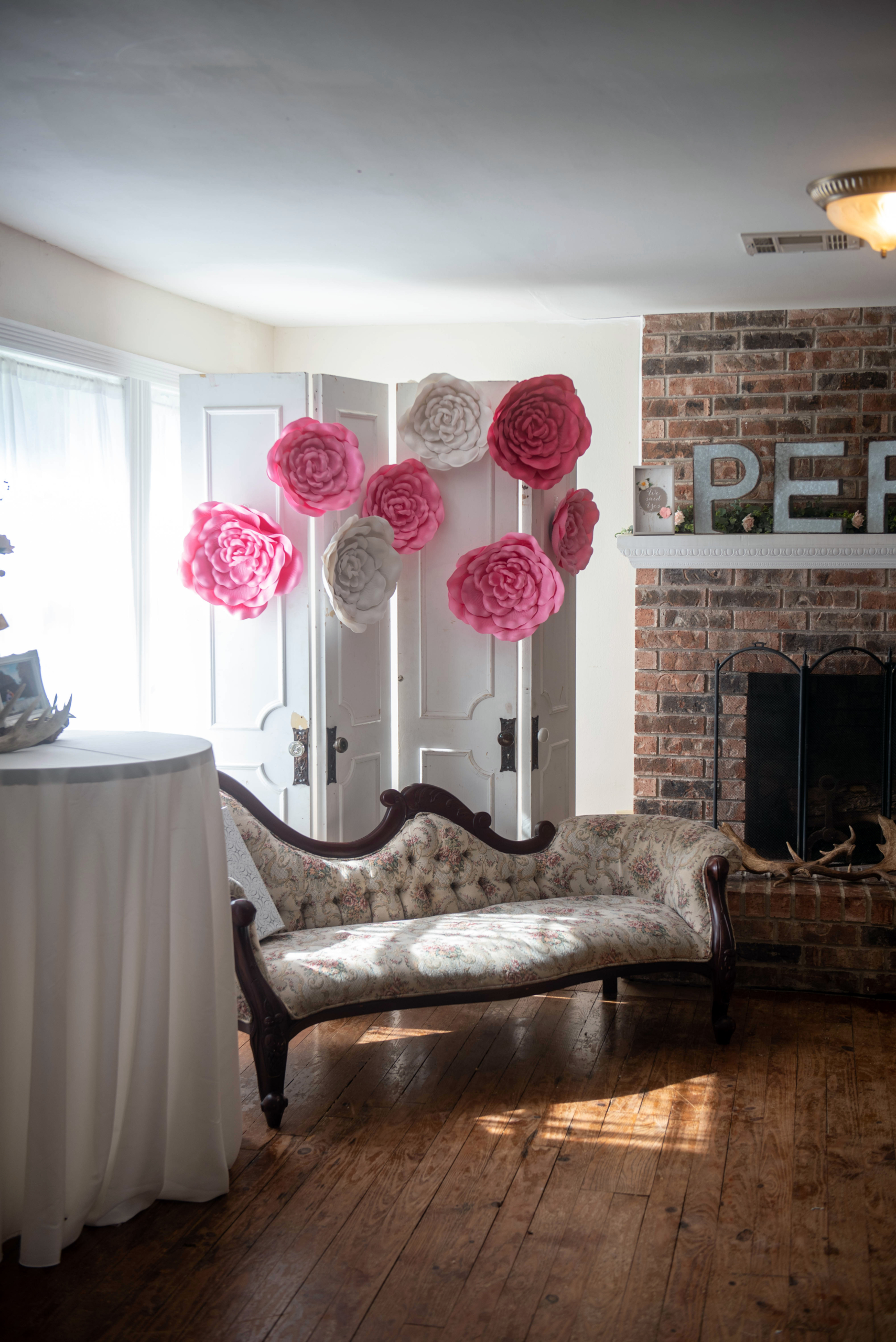 antique lounge with pink and white balloons in a sitting area for a bridal shower - Covid-19 Weddings