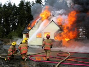 "ALT=""hostile fires being extinguished by firefighters, blog post image for Insurance Problem Solver and Luke Brown"""