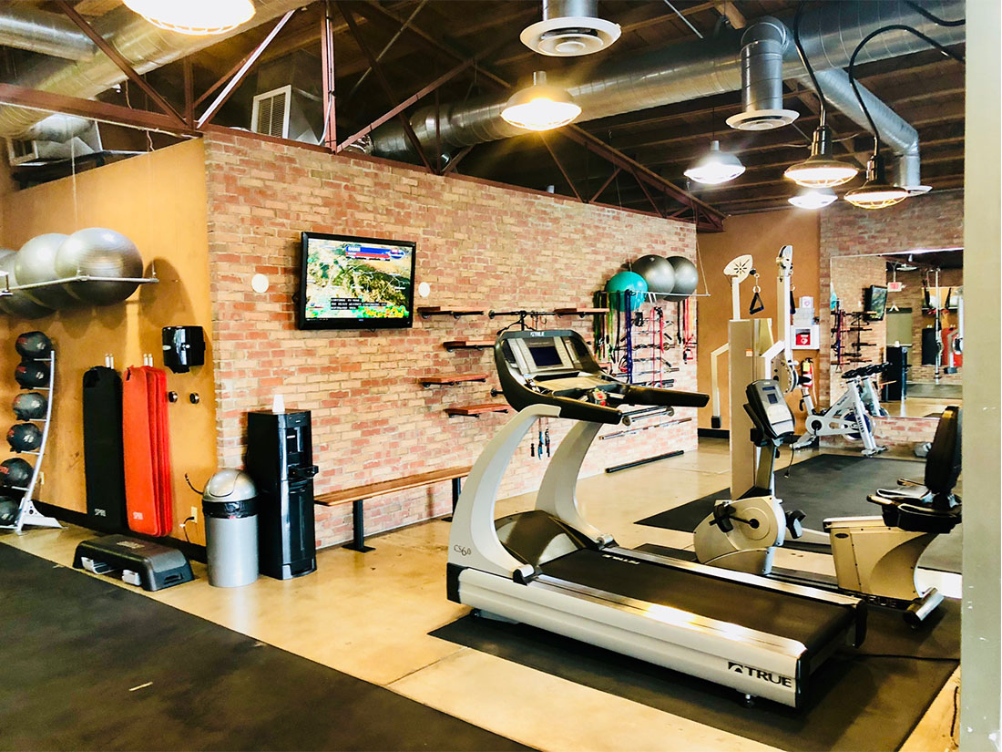 photo 10 of FIIT by Jason Smith facility showing a treadmill, recumbent bike, television, stability balls, medicine balls, rebok deck and more to maximize weight loss and muscle gain in Phoenix, AZ