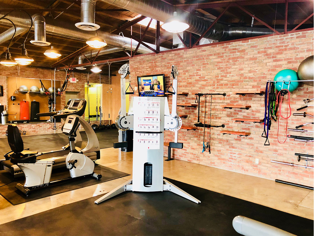 photo 9 of FIIT by Jason Smith facility showing functional training machine, recumbent bike, resistance bands, and stability balls to maximize weight loss and muscle gain in Phoenix, AZ