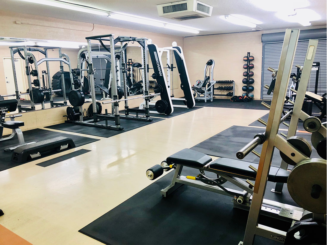 photo 7 of FIIT by Jason Smith showing rebok deck, bicep curl machine, bench press machine, leg curl machine, squat rack, medicine ball rack and more  so you can meet your fitness goal