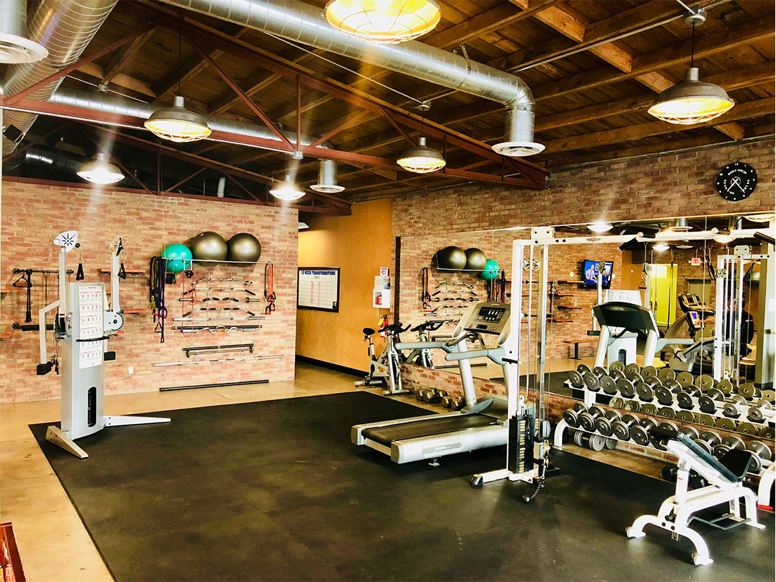 photo 5 of FIIT by Jason Smith showing functional training machine, medicine balls, treadmill, spin bike, cable crossover machine, dumbbell racks with dumbbells and adjustable incline bench for resistance training, core training and cardiovascular training in Phoenix, AZ