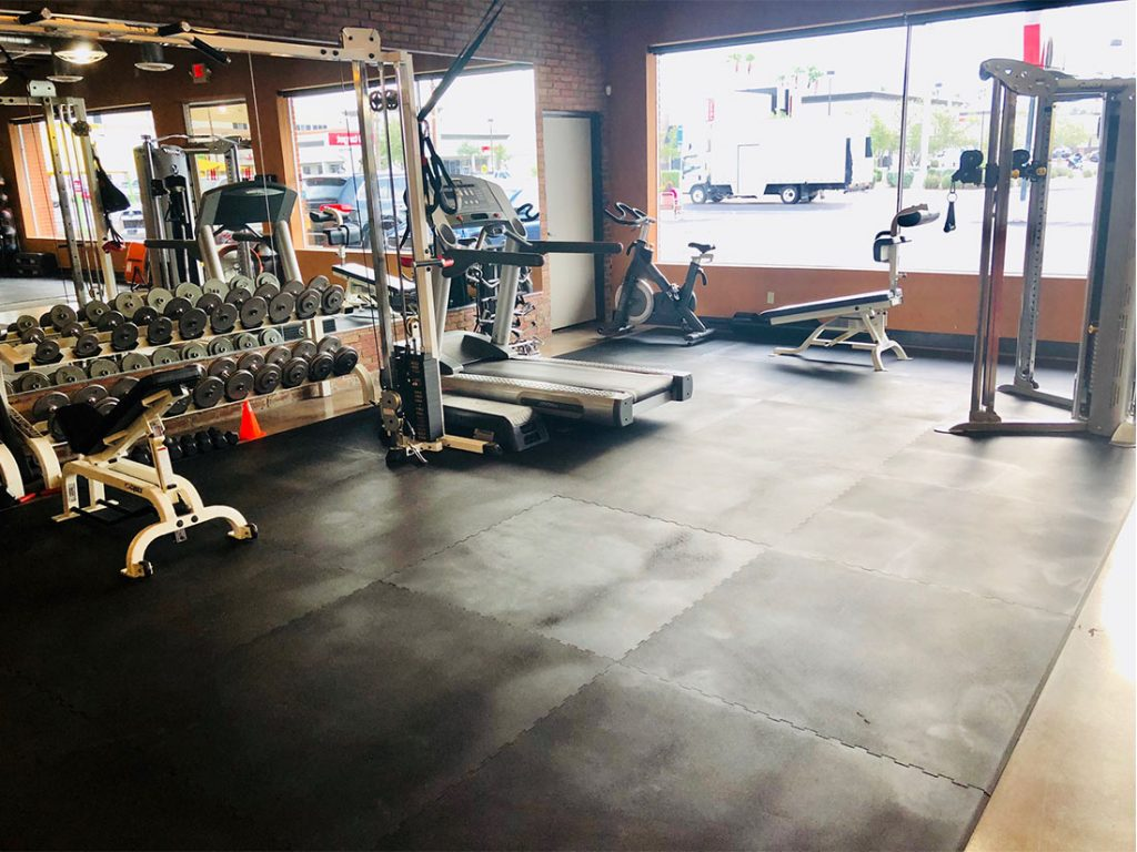 photo 3 of FIIT by Jason Smith facility showing cable crossover machine, treadmill, dumbbell racks, spin bike, TRX band, incline adjustable bench, Hoist Fitness machine and bar and attachment tree to maximize your weight loss