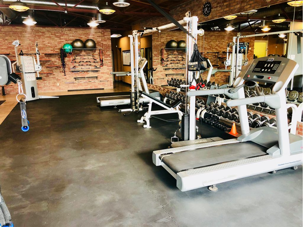 photo 2 of FIIT by Jason Smith facility showing dumbbell racks, treadmills, incline bench, resistance bands, resistance machine attachments and bars, functional training machine and cable crossover machine and more to maximize weight loss and muscle gain